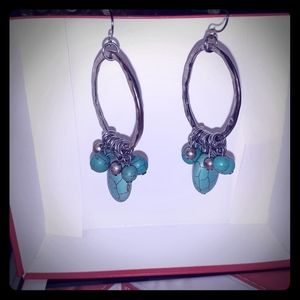 Turquoise color beads on these silver tone earring